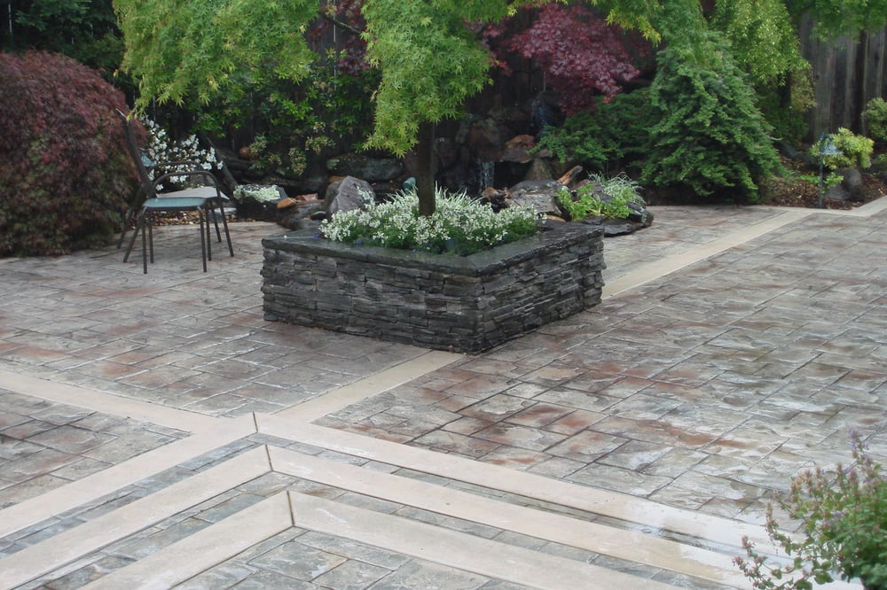 Stamped Concrete Patio With A Flagstone Planter Box Yelp