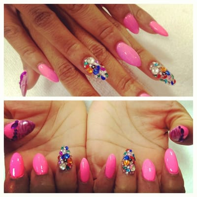 Stiletto nails and rhinestones with designs.