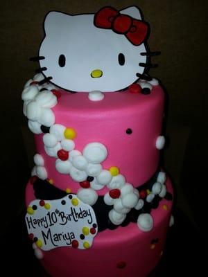 Two tier Hello Kitty Birthday cake.  Yelp