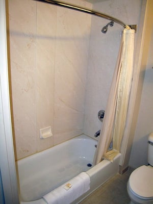 The Shower With Curved Shower Curtain Bar To Give You A