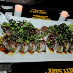 Pisces Sushi And Global Bistro logo