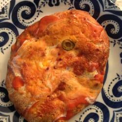 Rusted Sun Pizzeria logo