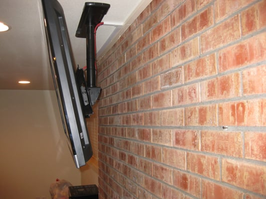Ceiling Installation Of A Tv Above A Brick Fireplace Yelp